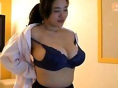 Korean girl with good-sized boobs tease
