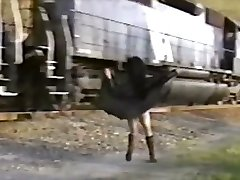 Asian dame in trench cover flashes train