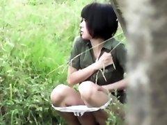 Asian bi-otches piss outdoors