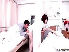 Splendid Japanese nurse gives a patient some partThree