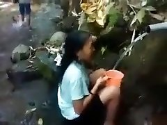Indonesia woman outdoor nature shower