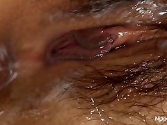 Young Asian babe receives a cream filled slit