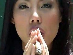 asian chick smoking cigar