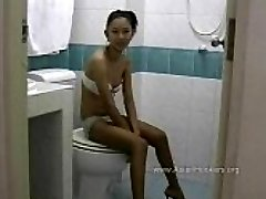 Thai Hooker Deep Throats Cock in the Rest Room