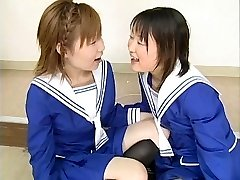 Two Japanese schoolgirls suck multiple dudes and swap jizz