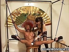 Restrained Asian chick tormented by her smoking steaming dominatrix