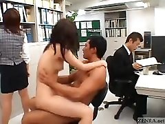 Asian couple ravages in the middle of an office