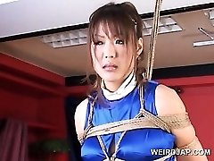 Corded asian pregnant sex slave gets huge tits pawed