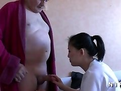 Young nurse blows an old man