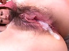 Pretty horn-mad Asian girlie with nice bra-stuffers takes dual penetration