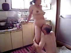 Japanese Milf at kitchen