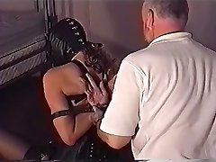 stringently bound corseted lady in leather