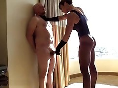 Muscular domme punishes and abases fat slave