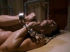 Playroom [2012] Chained dudes make small talk