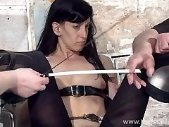 Feet torments of victim Elise Graves in dungeon bondage