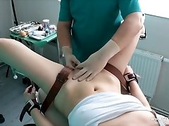 Girl's orgasm on the gynecological stool