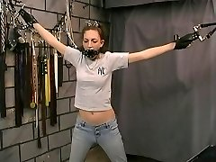 Bondaged slim a-cup dark-haired in face mask groped by bdsm master
