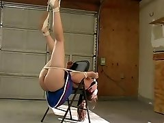Cheerleader bound to chair