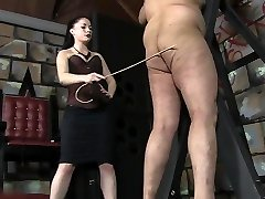 Sexy Dominatrix caning male slave