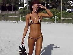 Extreme short bikini cameltoe strap on beach