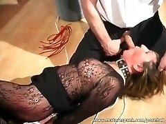 Mature bitch gets bound and penetrated with dildo