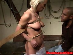 Mature beauty dominated in a dark dungeon space