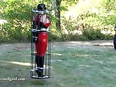 latex bondage gal jewell caged and stored in silo