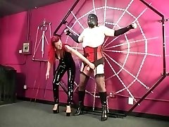 Domme Melissa torments ginormous slave