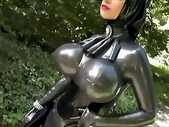 Girl in a silver latex dress
