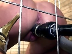 Lola Wan vulnerable in a cage bound gagged dildoed and vibrated