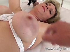 British mature Woman Sonia gagged and bound to the bed