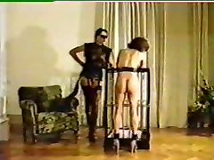 Domina tortures and brands new female victim