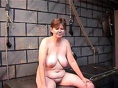 Old fuckslut's filthy ass goes red from spiked glove spanking in dungeon