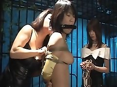Poor Asian chick awaits her penalty in a dungeon