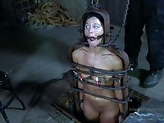 Strappado, claustrophobia and climax predicament for captive nymph.