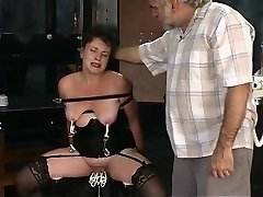 Two aged guys torment mature brunette in dungeon
