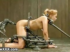 Immobilized on all 4 light-haired babe gets machine fucked