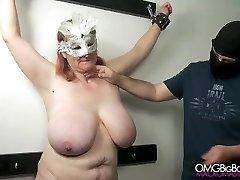 Huge-titted victim gets her massive naturals punished