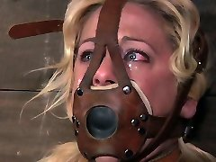 Uber-sexy blonde with nicely shaped caboose is chained and completely immobilized