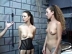 Cute young bondage & discipline nymphs are made to shock each other in the dungeon