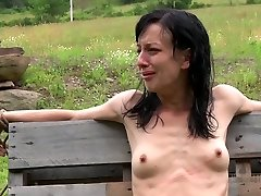 Anorexic brown-haired hussy gets her slender body corded up to wooden fence outdoors
