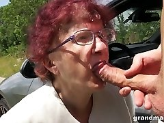 Kinky granny gives a blowjob and tugjob to one coddled youthful guy