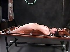 Tied and gagged brunette stunner gets an enema