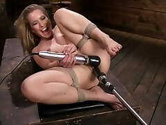 Lilly Lit gets fucked by machines in restrain bondage