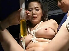 BDSM: Asian w catheter drained and re-packed