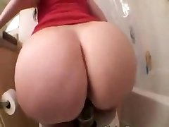 Pawg riding a phat black dildo on rest room