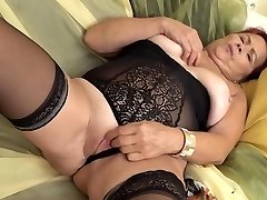 Red haired, Czech granny is wearing erotic, black lingerie and frolicking with a fucky-fucky toy