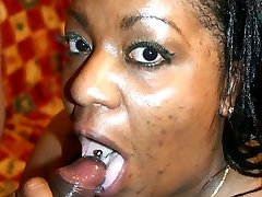 Big ass ebony BBW Carmyell slurping a big black cock and takes it in her cunt by grinding on top