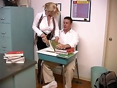 Mature blond with meaty breasts screwed by college girl in the classroom