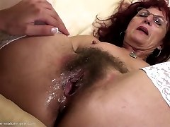 Deep fisting for handsome mature mom's hairy slit